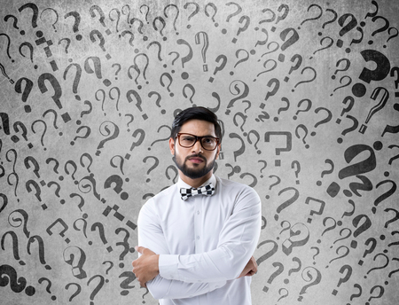 to contemplate: Thoughtful confused businessman Stock Photo
