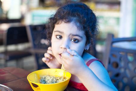 Girl eating Chinese food