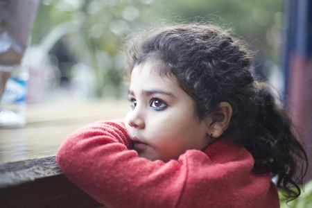 Girl looking out through window Stock Photo - 103117299