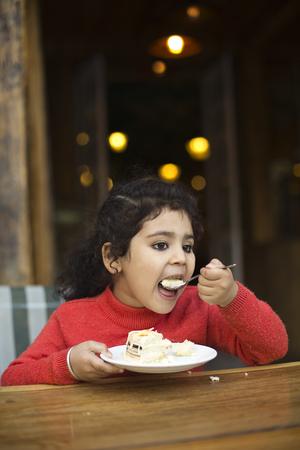Girl eating sweet pie Stock Photo