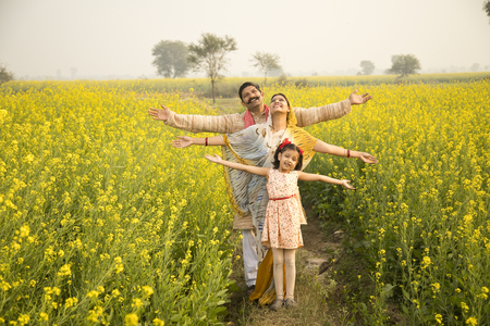 Rural Indian family in agricultural field