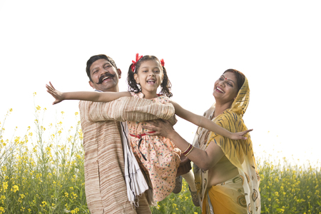 Rural Indian family having fun in agricultural field Stok Fotoğraf