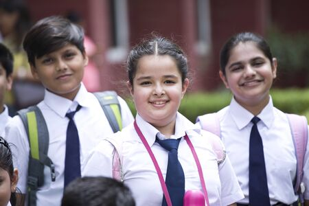 Group of schoolboys and schoolgirls at school campus
