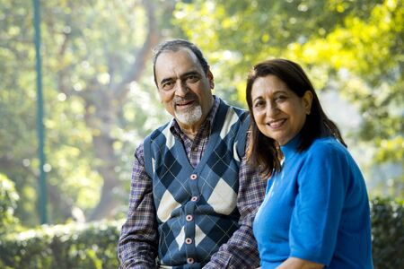 Portrait of senior couple smiling at park