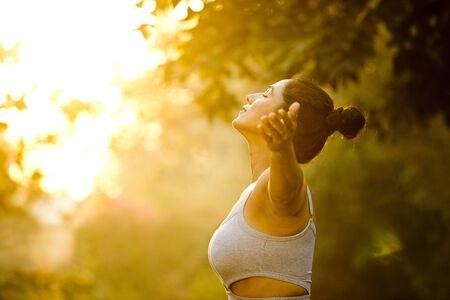 Beautiful woman exercising at park