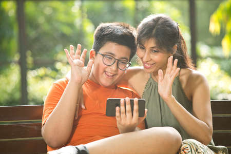Mother and son using mobile phone for video call Stock fotó