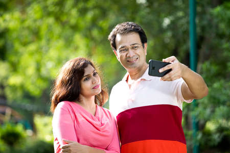 Indian couple on a video call using mobile phone