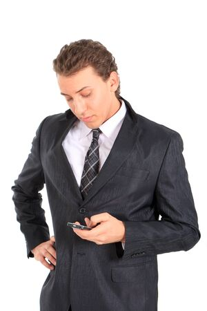 Young attractive businessman writing a text message. Isolated against white background. Stock Photo - 9013552
