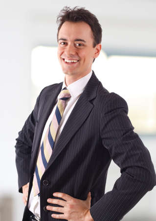 Young businessman smiling in his office Stock Photo - 9013625