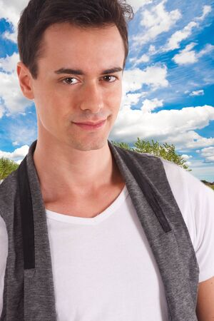 Young attractive man posing outdoor. Stock Photo - 9013524