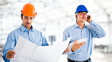 maintenance engineer: Portrait of two engineers at work Stock Photo