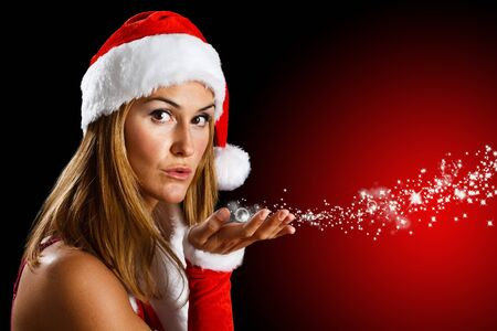 Portrait of a beautiful woman blowing stars Stock Photo - 11101637