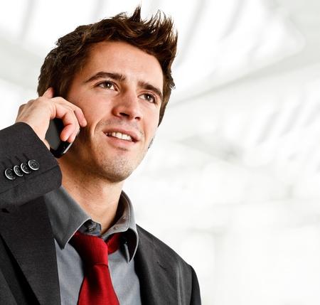 Portrait of a smiling businessman using a cellphone photo