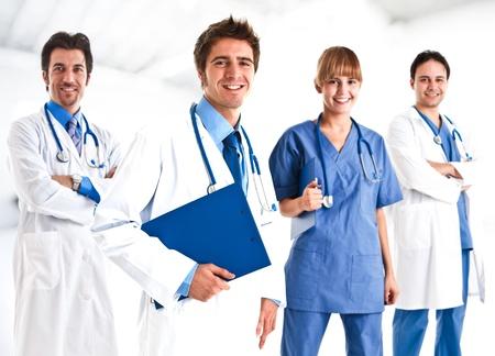 grupo de médicos: Retrato de un doctor y su equipo