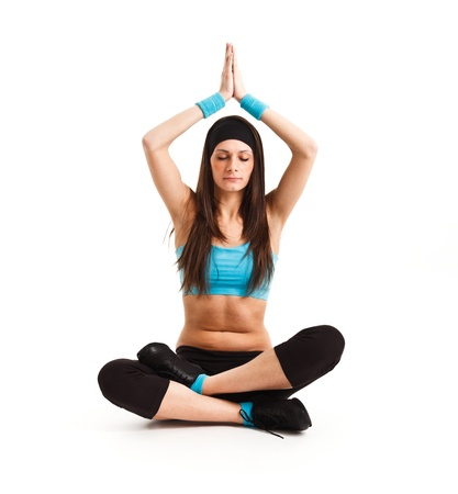 Beautiful young woman praticing meditation Stock Photo - 13944918