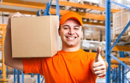 ship package: Portrait of an handsome deliverer Stock Photo