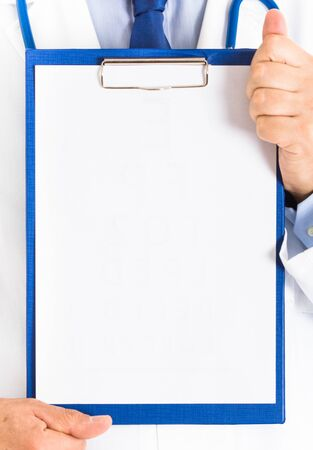 Doctor holding a blank medical chart photo