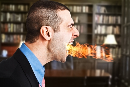 man mouth: Portrait of an angry businessman spitting fire