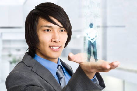 holography: Businessman holding an hologram in his hand Stock Photo