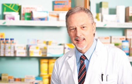Portrait of an happy handsome pharmacist photo