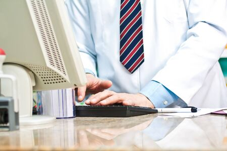 Doctor using a computer keyboard photo