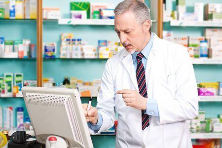 Pharmacist using a desktop computer photo