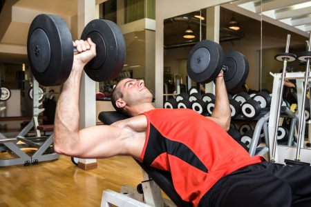 fitness club: Man training in a fitness club Stock Photo