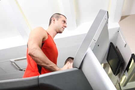 Man training in a fitness club Stock Photo - 13945152