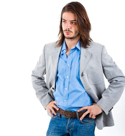 man with long hair: Portrait of a young handsome man isolated on white