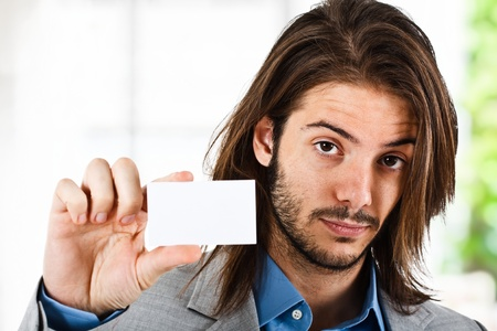 Funny man showing an empty piece of paper Stock Photo - 13979331