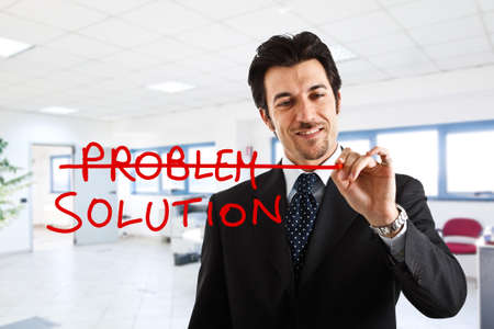 Businessman writing a positive concept on the screen photo