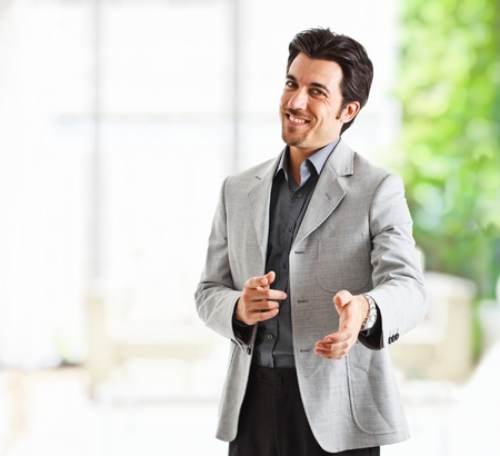 Portrait of an handsome businessman introducing himself Stock Photo - 13979191