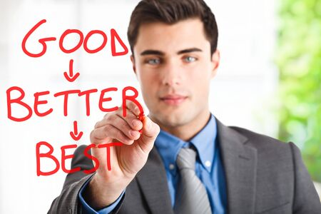 better business: Handsome businessman writing a motivational concept on the screen Stock Photo