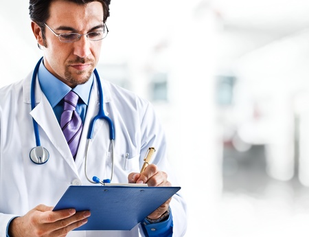 serious doctor: Portrait of a doctor writing a prescription Stock Photo