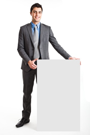Handsome businessman showing a blank board Stock Photo - 13979255