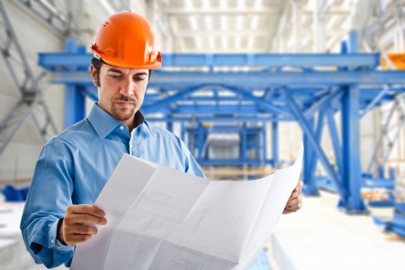 mechanical engineering: Portrait of a site manager reading a drawing Stock Photo