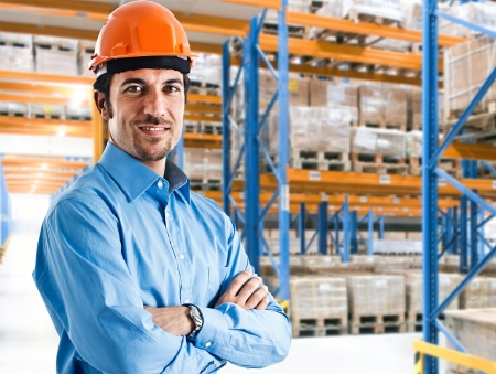 storekeeper: Portrait of a smiling warehouse-keeper at work Stock Photo