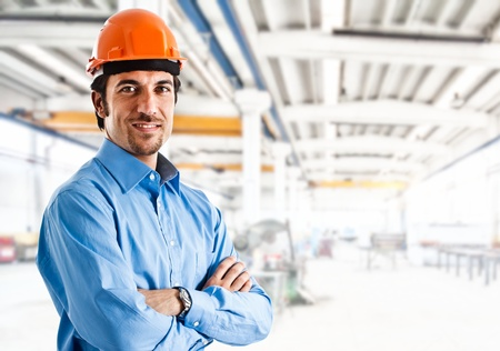 aerospace industry: Portrait of an handsome engineer in a factory Stock Photo