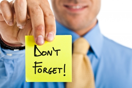 recall: Businessman reminding something using a post-it Stock Photo