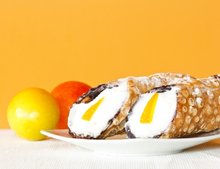 sicilian: Typical Sicilian fried thin pastry roll with sweet ricotta cheese, candied fruit and pieces of chocolate, called Cannolo