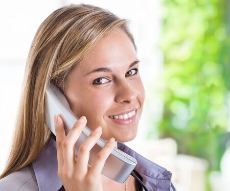 Beautiful woman talking on the phone photo