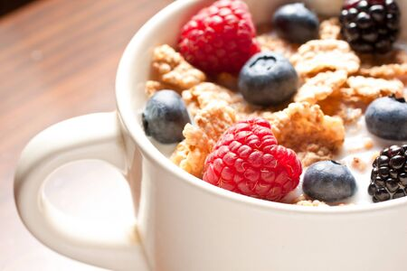 Healthy breakfast with milk, corn flakes and soft fruit Stock Photo - 14020017