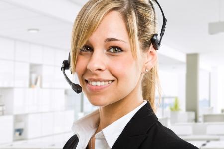 contact us: Portrait of a beautiful customer representative