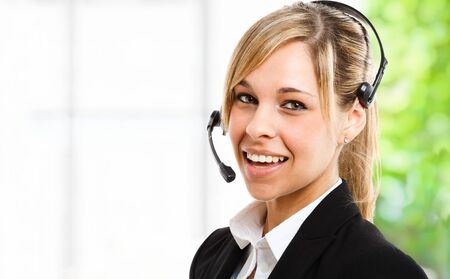 Portrait of a beautiful woman wearing an headset Stock Photo - 14013159