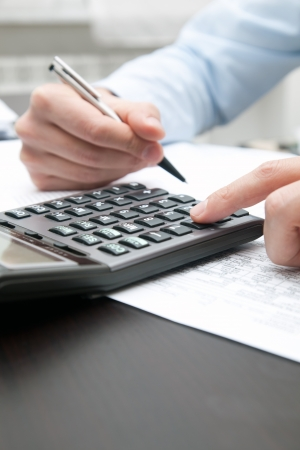 Business man using a calculator Stock Photo