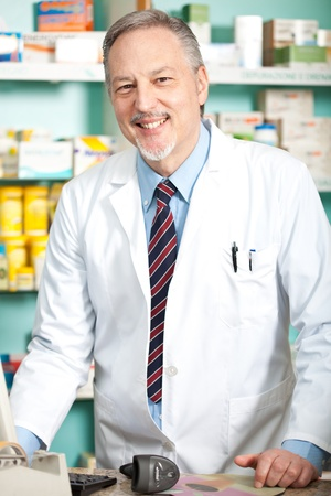 Portrait of a pharmacist in his shop photo
