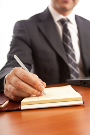 autograph: Businessman writing on a document Stock Photo