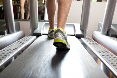 People using treadmills in a fitness club photo