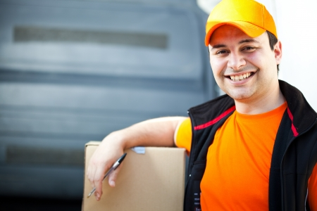 deliverer: Portrait of an handsome deliverer Stock Photo