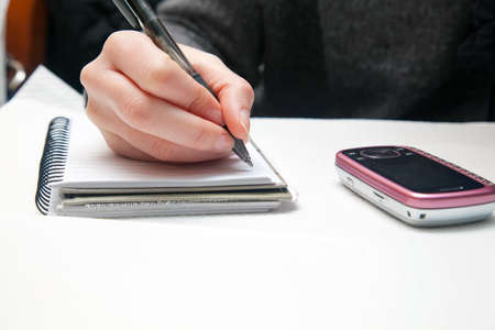 Businesswoman writing on a document photo